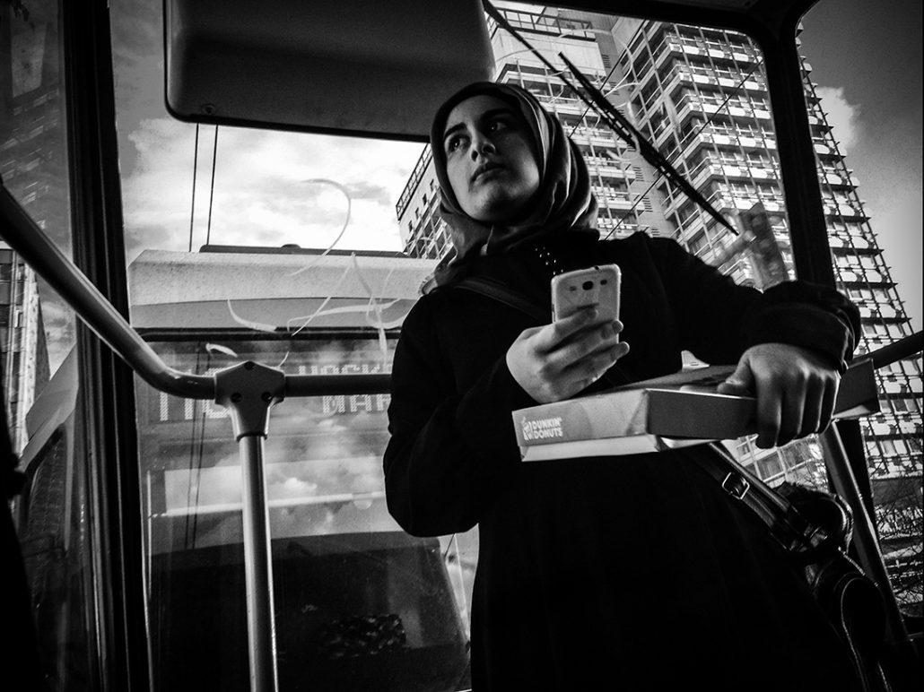 Muslim woman holding a donuts box