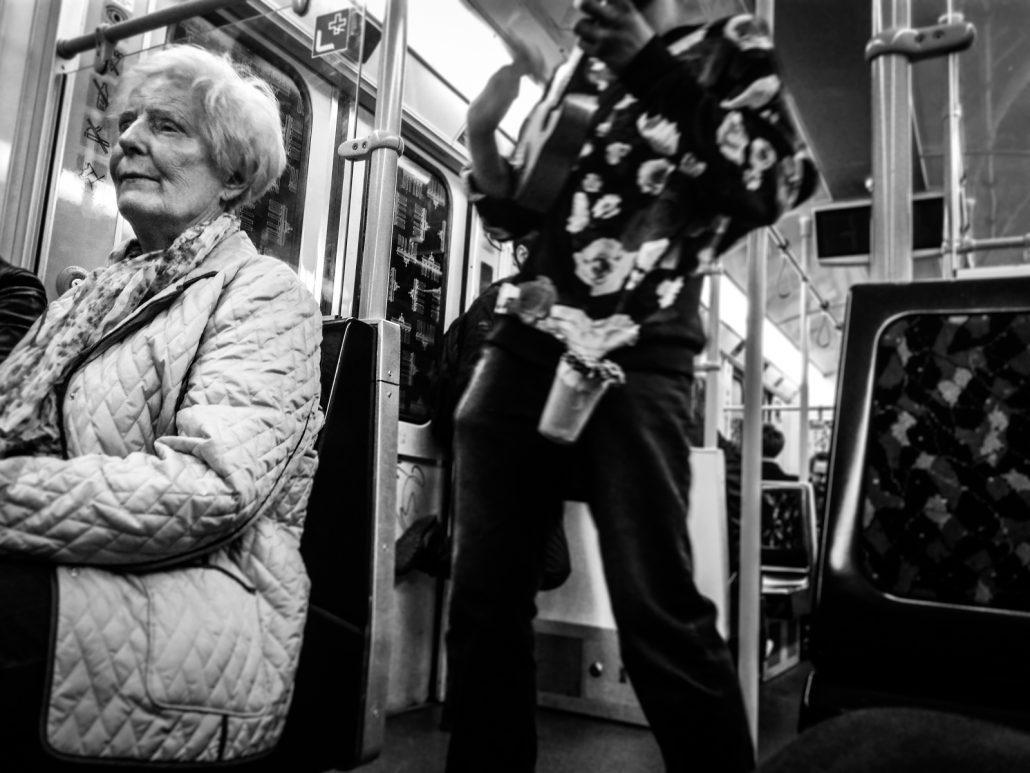 Old woman enjoying underground music