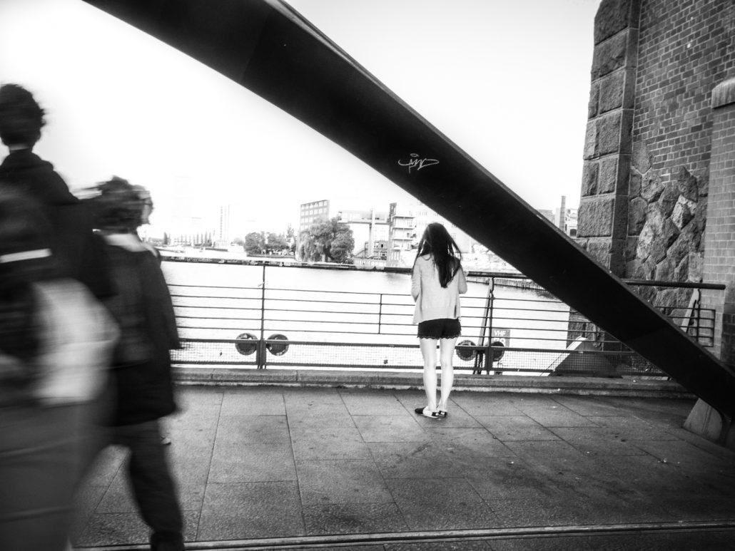 woman on a bridge feeling alone